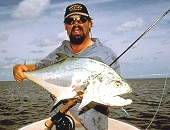 Steve Starling holding a Queenfish